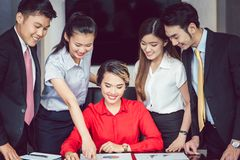 Businesspeople discussing on business project stock image