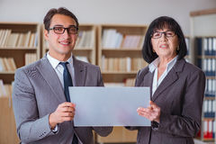 The businesspeople discussing business results on tablet computer Stock Photos