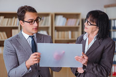 The businesspeople discussing business results on tablet computer Royalty Free Stock Photos