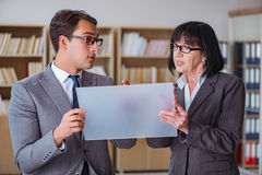 The businesspeople discussing business results on tablet computer Royalty Free Stock Photography