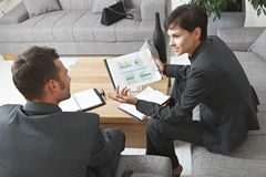 Businesspeople discussing charts Stock Photos