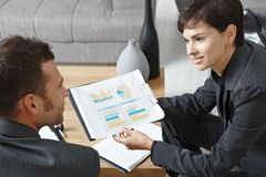 Businesspeople discussing charts Royalty Free Stock Image