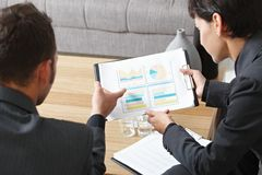 Businesspeople discussing charts Royalty Free Stock Photo