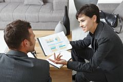 Businesspeople discussing charts Stock Images