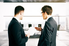 Businesspeople discussing contract terms Stock Photo