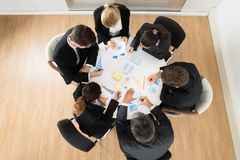 Businesspeople discussing graph Royalty Free Stock Image