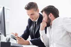 Businesspeople discussing job issues Royalty Free Stock Images
