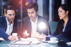 Businesspeople discussing over digital tablet Royalty Free Stock Photography
