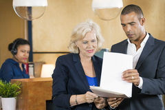 Businesspeople Discussing Over Documents Royalty Free Stock Image