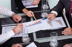 Businesspeople discussing plan in office Royalty Free Stock Photo