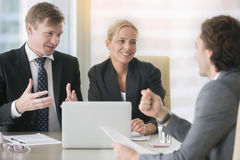 Businesspeople discussing proposal Stock Photo