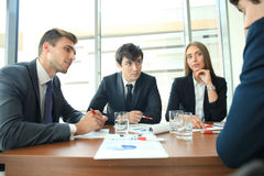 Businesspeople discussing together in conference room during meeting at office. Businesspeople discussing together in conference room during meeting at office Stock Photography