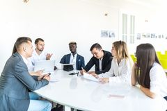 Businesspeople discussing together in conference room during meeting at office. Team work stock photo