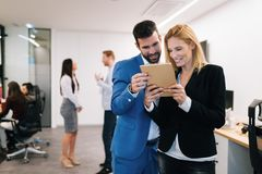 Businesspeople discussing while using digital tablet in office. Together royalty free stock images
