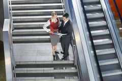Businesspeople Discussing Work On Stairs Royalty Free Stock Images