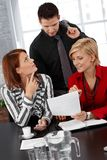 Businesspeople at discussion. Smiling businesspeople at discussion of documents at meeting stock images