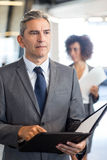 Businesspeople with document and organizer Stock Images