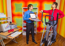 Businesspeople doing exercise Stock Images