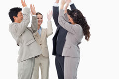 Businesspeople doing self-motivation ritual Royalty Free Stock Photos