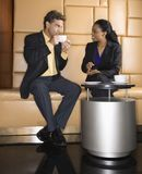 Businesspeople drinking coffee. Stock Images
