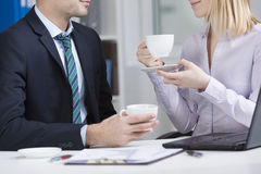 Businesspeople drinking coffee Royalty Free Stock Images