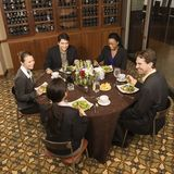 Businesspeople eating. Stock Images