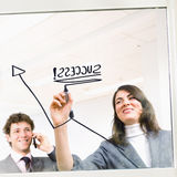 Businesspeople en grafiek Royalty-vrije Stock Afbeeldingen