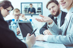 Businesspeople evolving new strategy. Young businesspeople evolving new company strategy during business meeting in office stock image