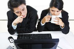 Businesspeople examining monitor Royalty Free Stock Photography