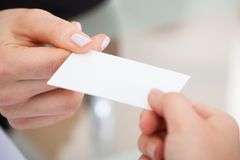 Businesspeople exchanging visiting card Stock Images