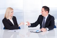 Businesspeople Exchanging Visiting Card Royalty Free Stock Photo