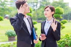 Businesspeople feel hot. When having a talk outdoors stock images