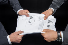 Businesspeople fighting for documents Stock Photography