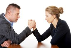 Businesspeople fighting on hands Royalty Free Stock Photo