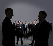Businesspeople figures. Handshake. Stock Photo