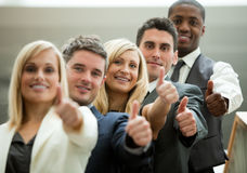 Businesspeople with fists in front Stock Photos