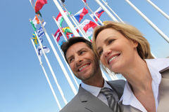 Businesspeople with flags. Stock Images