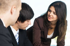 Businesspeople flirting in work Royalty Free Stock Photography