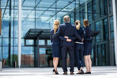 Businesspeople forming a huddle in office premises. Group of businesspeople forming a huddle in office premises Stock Image