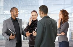 Businesspeople front of office building. Businesspeople talking front of office building royalty free stock photo