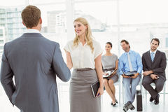 Businesspeople in front of people waiting for interview Royalty Free Stock Photo