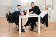 Businesspeople Getting Bored In Office Stock Image