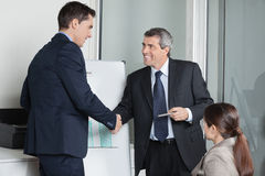 Businesspeople giving handshake Royalty Free Stock Images