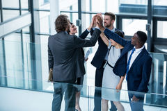 Businesspeople giving high five to each other Royalty Free Stock Image