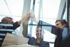 Businesspeople giving a high five to each other Royalty Free Stock Images