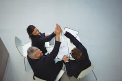 Businesspeople giving a high five to each other Stock Photography