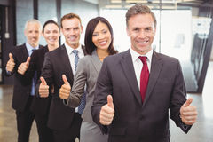 Businesspeople giving thumbs up Stock Photography