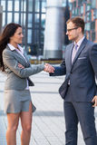 Businesspeople are going to shake-hands. Royalty Free Stock Image