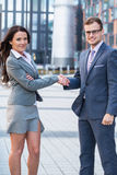 Businesspeople are going to shake-hands. Stock Images