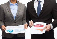 Businesspeople with graphs and charts Royalty Free Stock Images